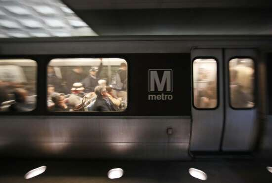 A Metro train departs the Gallery Place-Chinatown Metro Station, Thursday, Jan. 11, 2018, in Washington. Washington's Metro system has become internationally synonymous with delays, breakdowns and smoke-filled tunnels. (AP Photo/Alex Brandon)