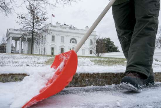 A National Park Service worker clears snow on the North side of the White House, Thursday, Jan. 4, 2018, in Washington. Residents across a huge swath of the U.S. have awakened to the beginnings of a massive winter storm expected to deliver snow, ice and high winds followed by possible record-breaking cold as it moves up the Eastern Seaboard from the Carolinas to Maine. (AP Photo/Andrew Harnik)