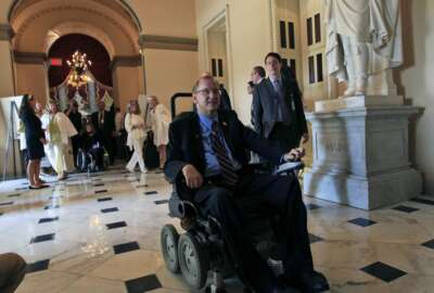 Rep. Jim Langevin, D-R.I., heads to the House floor on Capitol Hill in Washington Monday, July 26, 2010, to preside over the House after an event celebrating the Americans with Disabilities Act, ADA, in Statuary Hall. (AP Photo/Alex Brandon)