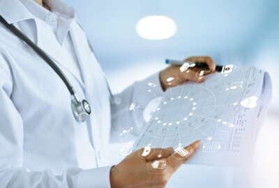 Medicine doctor and medical Report in hand with icon medical network connection in hospital background, medical technology network concept