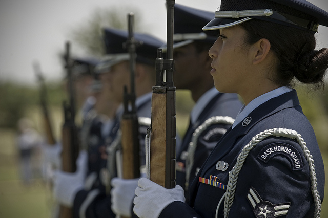 U.S. Air Force Airman 1st Class Twila Stone readies her weapon during a Memorial Day ceremony May 28, 2012, at the Texas State Veteran Cemetery in Abilene, Texas. Memorial Day is a day of remembering the men and women who died while serving in the United States Armed Forces. Stone is assigned to the 7th Logistics Readiness Squadron.