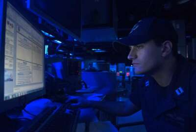 PHILIPPINE SEA (March 8, 2017) Lt. Christian Asaban views a computer monitor aboard the forward-deployed Arleigh Burke-class guided-missile destroyer USS Fitzgerald (DDG 62) during Multisail 17. The exercise is a bilateral training exercise improving interoperability between the U.S. and Japanese forces. This exercise benefits from realistic, shared training enhancing our ability to work together to confront any contingency. Text on the monitor has been blurred for security purposes.(U.S. Navy photo by Mass Communication Specialist 2nd Class William McCann/Released)