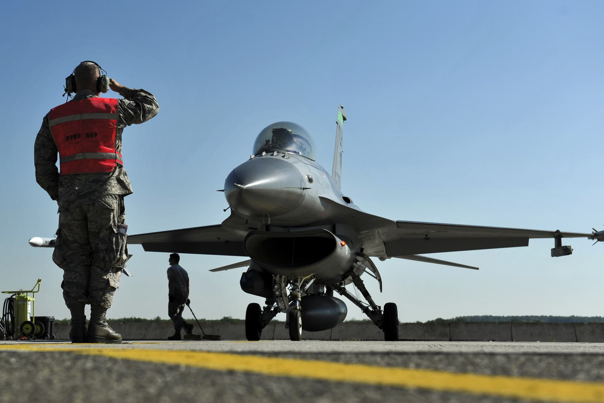 Master Sgt. Joe Ray, a weapons loader assigned to the 180th Fighter Wing, Ohio Air National Guard, salutes as Capt. Justin Kreischer, an 180th FW F-16 Fighting Falcon pilot, prepares to take off for a training sortie at Kecskemet Air Base, Hungary. Approximately 150 Airmen and eight F-16 fighter jets from the 180th FW traveled to the air base to participate in Load Diffuser 17, a two-week Hungarian-led multinational exercise focused on enhancing interoperability capabilities and skills among NATO allied and European partner air forces by conducting joint operations and air defenses to maintain joint readiness, while also bolstering relationships within the U.S. Air National Guard's State Partnership Program initiatives. Ohio became state partners with Hungary in 1993. (U.S. Air National Guard photo/Senior Master Sgt. Beth Holliker.)