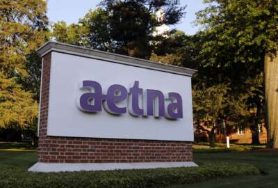 FILE - In this June 1, 2017, file photo, a sign stands on the campus of the Aetna headquarters, in Hartford, Conn. Insurers are dropping billions of dollars on acquisitions and expansions as they get more involved in their customers' health. Late last year, CVS Health announced a roughly $69 billion deal to buy another insurer, Aetna. Those companies plan to convert drugstores into health care hotspots that people can turn to for a variety of needs in between doctor visits. (AP Photo/Bill Sikes, File)