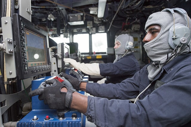 Gunner's Mate 2nd Class Joe Tyson, front, and Gunner's Mate 2nd Class Jake Anderson, both assigned to Arleigh Burke-class guided-missile destroyer USS Dewey (DDG 105), man MK 38 MOD 2 mount consoles in the ship's pilot house during an integrated training team (ITT) drill. Dewey is on a scheduled deployment to conduct operations in the Indo-Pacific region. It will also support the Wasp Expeditionary Strike Group (ESG) in order to advance U.S. Pacific Fleet's Up-Gunned ESG concept and will train with forward-deployed amphibious ships across all mission areas.