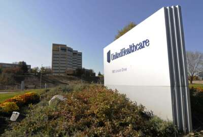 FILE - This Oct. 16, 2012, file photo, shows a portion of the UnitedHealth Group Inc.'s campus in Minnetonka, Minn. The nation's largest health insurer plans to give some customers a break at the pharmacy counter starting next year. UnitedHelathcare said Tuesday, March 6, 2018, that it will pass along rebates from drug manufacturers to customers when they fill a prescription. Those rebates could amount to a few bucks or several hundred dollars, depending on the drug. (AP Photo/Jim Mone, File)