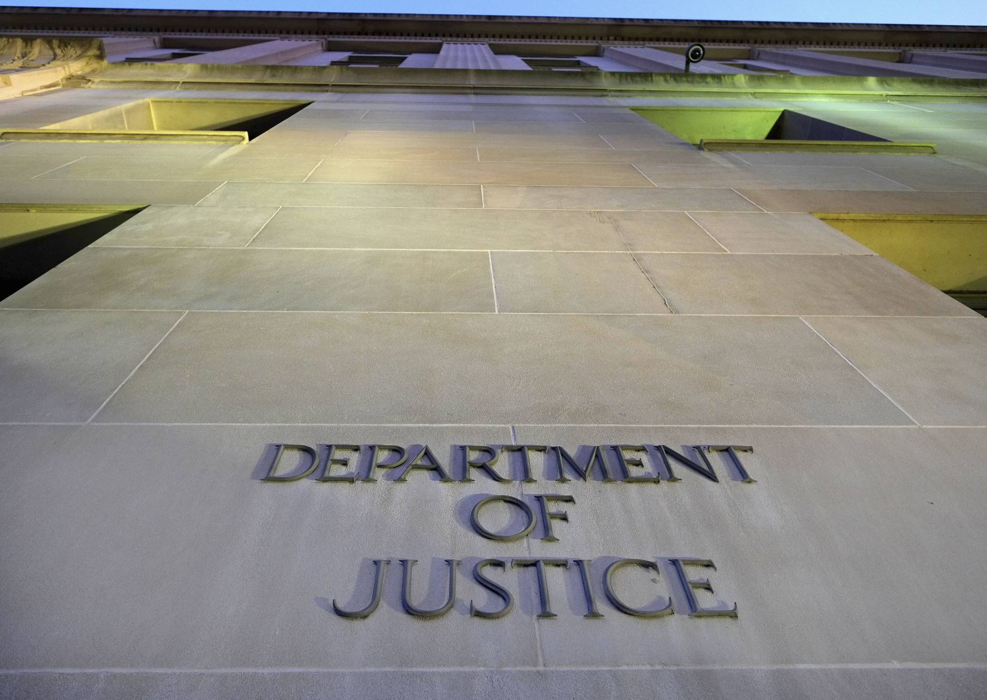 FILE - In this May 14, 2013, file photo, the Department of Justice headquarters building in Washington is photographed early in the morning. The federal government censored, withheld or said it couldn't find records sought by citizens, journalists and others more often last year than at any point in the past decade, according to an Associated Press analysis of new data. The highest number of requests went to the departments of Homeland Security, Justice, Defense, Health and Human Services, and Agriculture, along with the National Archives and Records Administration and Veterans Administration. (AP Photo/J. David Ake, File)