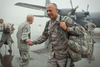 Even the rain cannot stop friends and families from reuniting with Airmen of the 934th Airlift Wing as they return from overseas. The Airmen have been deployed since early 2012 from the Minneapolis-St. Paul International Airport Air Reserve Station, Minn. (Shannon McKay)