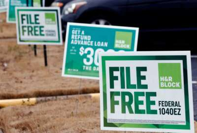 FILE- In this Feb. 14, 2018, file photo, H&R Block signs are displayed in Jackson, Miss. The tax deadline does typically fall on April 15 but that's a Sunday this year and Monday is Emancipation Day, a Washington D.C. holiday. That means that taxpayers nationwide get a little breathing room and have until Tuesday, April 17, to get the job done. (AP Photo/Rogelio V. Solis, File)