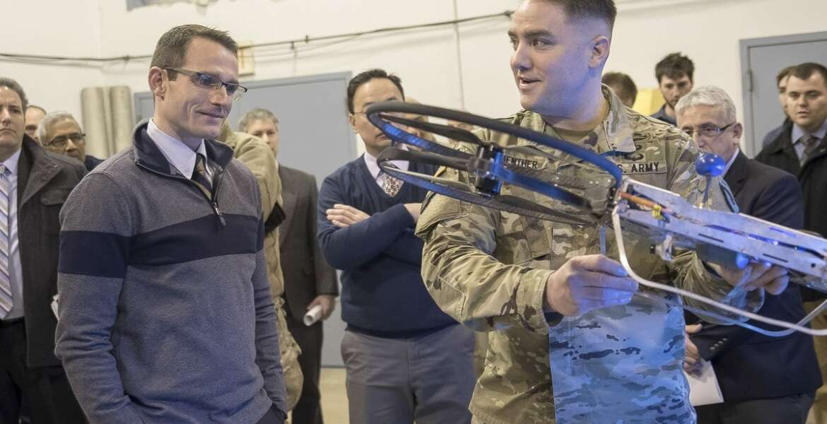 Sgt. 1st Class Daniel Guenther, right, of the U.S. Army Research Laboratory, explains the Joint Tactical Aerial Resupply Vehicle concept to then-Strategic Capabilities Office Director William Roper, left, using a small-scale model at Aberdeen Proving Ground in Maryland on Jan. 10, 2017.