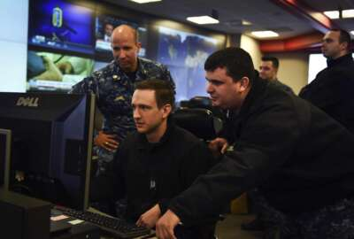 171214-N-JS206-0005 FORT GEORGE G. MEADE, Md. (Dec. 14, 2017) Sailors stand watch in the Fleet Operations Center at the headquarters of U.S. Fleet Cyber Command/U.S. 10th Fleet. U.S. Fleet Cyber Command serves as the Navy component command to U.S. Strategic Command and U.S. Cyber Command. U.S. 10th Fleet is the operational arm of Fleet Cyber Command and executes its mission through a task force structure. (U.S. Navy photo by Mass Communication Specialist Samuel Souvannason/Released)