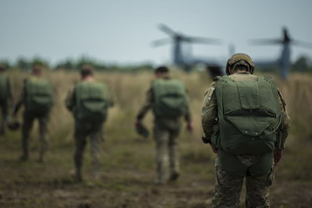 U.S. Army special operations forces walk to a Marine Corps MV-22 Osprey tiltrotor aircraft to conduct a high-altitude, low-opening jump with Philippine and Australian special operations forces May 7, 2014, during Balikatan 2014 at Fort Magsaysay, Philippines. Balikatan is an annual bilateral training exercise designed to increase interoperability between the Armed Forces of the Philippines and the U.S. military when responding to future natural disasters.