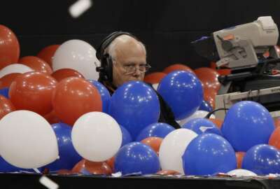A camera man is buried in balloons at the Republican National Convention in St. Paul, Minn., Thursday, Sept. 4, 2008.  (AP Photo/Charlie Neibergall)