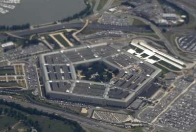 FILE - In this June 3, 2011, file photo, the Pentagon is seen from air from Air Force One. The Defense Department has approved new restrictions for the use of cellphones and some other electronic devices in the Pentagon where classified information is present or discussed. But officials stopped far short of imposing an all-out ban. (AP Photo/Charles Dharapak, File)