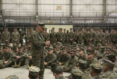 Commandant of the Marine Corps Gen. Robert B. Neller addresses Marines and Sailors assigned to Special Purpose Marine Air-Ground Task Force-Crisis Response-Africa, during a ceremony at Naval Air Station Sigonella, Italy, Dec. 25, 2017. Neller and Sgt. Maj. Ronald L. Green, sergeant major of the Marine Corps stopped by NAS Sigonella to spend time with SPMAGTF-CR-AF service members during the holidays. SPMAGTF-CR-AF is deployed to conduct crisis-response and theater-security operations in Europe and Africa. (U.S. Marine Corps photo by Lance Cpl. Patrick Osino) www.dvids.hub.net