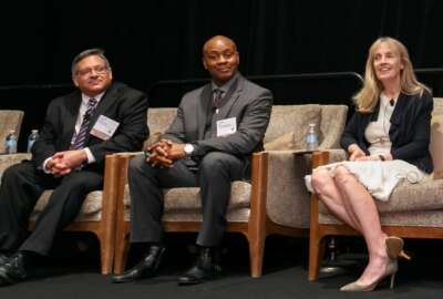 Darren Ash, left, assistant CIO for the Farm Production and Conservation Mission Area at USDA; Gary Washington, center, USDA CIO; and Joanne Collins-Smee, deputy commissioner in GSA's Federal Acquisition Service and director of the Technology Transformation Service.