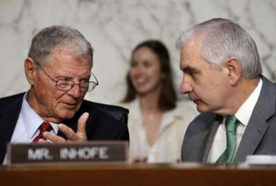 Sen. Jim Inhofe, R-Okla., left, speaks with Senate Armed Services Committee Ranking Member Sen. Jack Reed, D-R.I., during a committee hearing with Defense Secretary Jim Mattis on the Department of Defense budget posture, Thursday April 26, 2018, on Capitol Hill in Washington.
