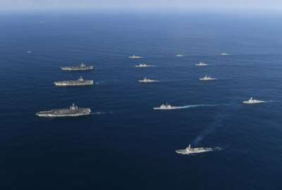 """FILE - In this Nov. 12, 2017, file photo provided by South Korea Defense Ministry, three U.S. aircraft carriers USS Nimitz, left top, USS Ronald Reagan, left center, and USS Theodore Roosevelt, left bottom, participate with other U.S. and South Korean navy ships during a joint naval exercises between the United States and South Korea in waters off South Korea's eastern coast. U.S. President Donald Trump promised to end """"war games"""" with South Korea, calling them provocative, after meeting North Korean leader Kim Jong Un on June 12, 2018. His announcement appeared to catch both South Korea and the Pentagon by surprise. (South Korea Defense Ministry via AP, File)"""