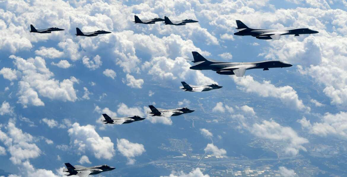 """FILE - In this Sept. 18, 2017, file photo provided by South Korea Defense Ministry, U.S. Air Force B-1B bombers, F-35B stealth fighter jets and South Korean F-15K fighter jets fly over the Korean Peninsula during a joint drills. U.S. President Donald Trump promised to end """"war games"""" with South Korea, calling them provocative, after meeting North Korean leader Kim Jong Un on June 12, 2018. His announcement appeared to catch both South Korea and the Pentagon by surprise. (South Korea Defense Ministry via AP, File)"""