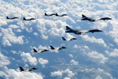FILE - In this Sept. 18, 2017, file photo provided by South Korea Defense Ministry, U.S. Air Force B-1B bombers, F-35B stealth fighter jets and South Korean F-15K fighter jets fly over the Korean Peninsula during a joint drills, South Korea. The on-again, off-again meeting between President Donald Trump and North Korean leader Kim Jong Un has been an emotional roller coaster for South Koreans. With the summit now set for Tuesday, they await the historic event with both hopes and doubts. (South Korea Defense Ministry via AP, File)