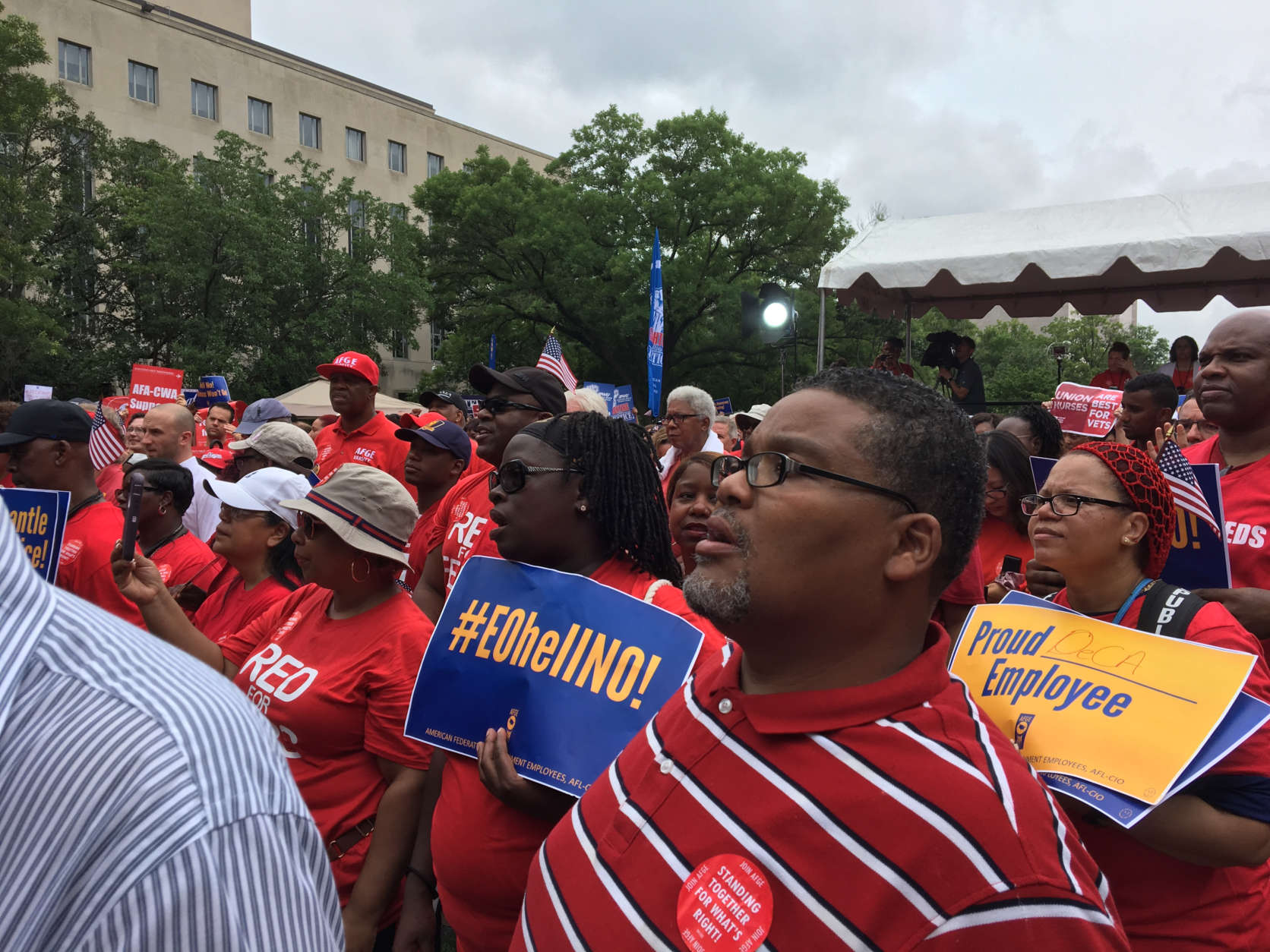 Fed unions protest on day of federal court challenge to