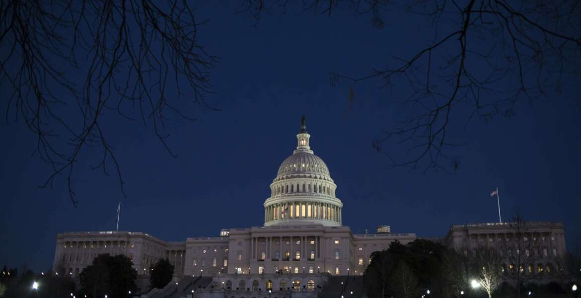 FILE - In this Jan. 19, 2018, file photo, the Capitol is illuminated in Washington. Lawmakers are honing their messaging for the midterm elections as their summer recess looms. (AP Photo/J. Scott Applewhite, File)