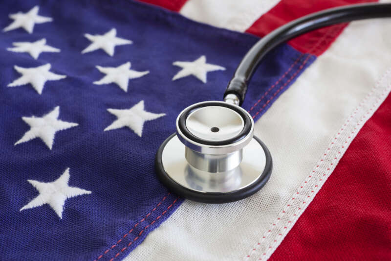 Healthcare reform concept with stethoscope and USA flag.