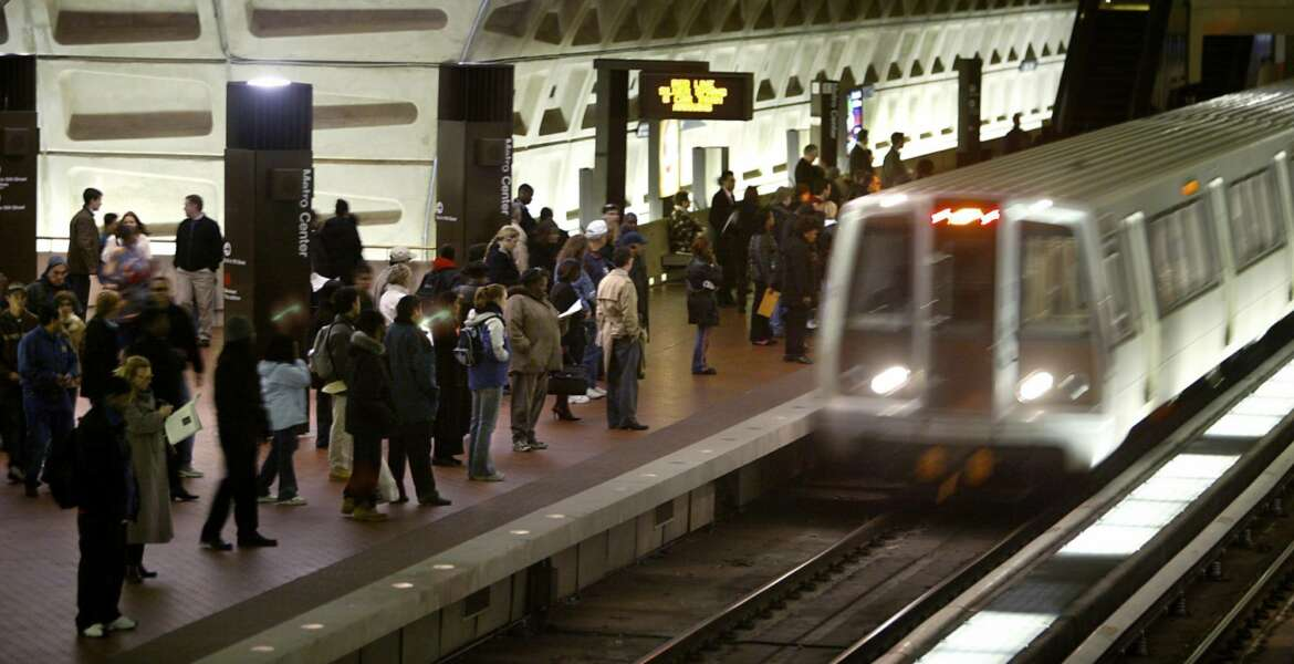 FILE - In a Monday, April 5, 2004 file photo, riders wait to board an arriving train at the D.C. Metro Center, in Washington. Metro's largest union has overwhelmingly authorized a potential transit system strike, just as thousands of tourists arrive in the nation's capital for the July 17, 2018 Major League Baseball All-Star Game. Union leaders said they would wait on Monday's expected response from Metro's management after Sunday's vote authorizing a strike.  (AP Photo/Lawrence Jackson, File)
