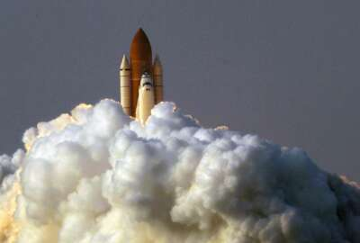 FILE - In this Aug. 8, 2007 file photo by Associated Press photojournalist Alan Diaz, the space shuttle Endeavour lifts off from the Kennedy Space Center in Cape Canaveral, Fla. Diaz, whose photo of the terrified 6-year-old Cuban boy named Elian Gonzalez earned him the Pulitzer Prize, died Tuesday, July 3, 2018, his daughter Aillette Rodriguez-Diaz said. He was 71. (AP Photo/Alan Diaz)