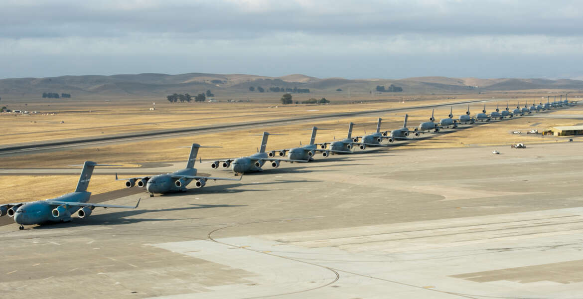 Seven U.S. Air Force C-17 Globemaster III aircraft, 11 KC-10 Extender aircraft and four C-5 Galaxy aircraft assigned to the 60th Air Mobility Wing line up at Travis Air Force Base, Calif., Sept. 11, 2013, for the Freedom Launch honoring the victims of the 9/11 terrorist attacks. The first plane departed at 8:46 a.m., the same time terrorists crashed American Airlines Flight 11 into the North Tower of the World Trade Center, with the remaining 21 aircraft launching consecutively during a 36-minute time frame. Terrorists hijacked four passenger aircraft Sept. 11, 2001. Two of the aircraft were deliberately crashed into the World Trade Center in New York; one was crashed into the Pentagon; the fourth crashed near Shanksville, Pa. Nearly 3,000 people died in the attacks. (U.S. Air Force photo by Heide Couch/Released)