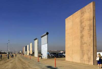 FILE - This Oct. 26, 2017 file photo shows prototypes of border walls in San Diego. A federal appeals court will hear arguments by the state of California that the Trump administration overreached by waiving environmental reviews to speed construction of the president's prized border wall with Mexico. At issue Tuesday, Aug. 7, 2018, before a three-judge panel in Pasadena, Calif., is a 2005 law that gave the Homeland Security secretary broad authority to waive dozens of laws including the National Environmental Policy Act and Endangered Species Act. (AP Photo/Elliott Spagat, File)