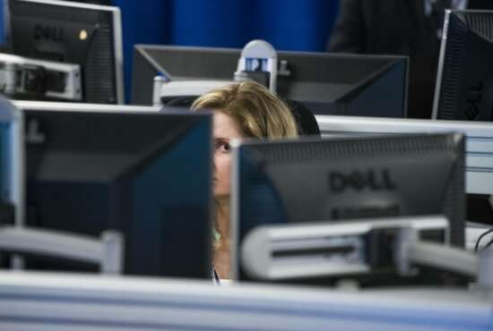 A worker is surrounded by computer monitors in the Department of Homeland Security's National Cybersecurity and Communications Integration Center (NCCIC) in Arlington, Va., Wednesday, Aug. 22, 2018. The center serves as the hub for the federal government's cyber situational awareness, incident response, and management center for any malicious cyber activity. (AP Photo/Cliff Owen)