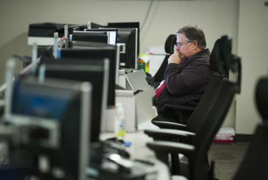 A workers sits a computer at the Department of Homeland Security's National Cybersecurity and Communications Integration Center (NCCIC) in Arlington, Va., Wednesday, Aug. 22, 2018. The center serves as the hub for the federal government's cyber situational awareness, incident response, and management center for any malicious cyber activity. (AP Photo/Cliff Owen)