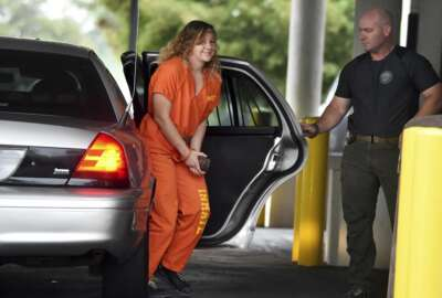 Reality Winner arrives at a courthouse in Augusta, Ga., Thursday, Aug. 23, 2018, after she pleaded guilty in June to copying a classified U.S. report and mailing it to an unidentified news organization. (Michael Holahan/The Augusta Chronicle via AP)