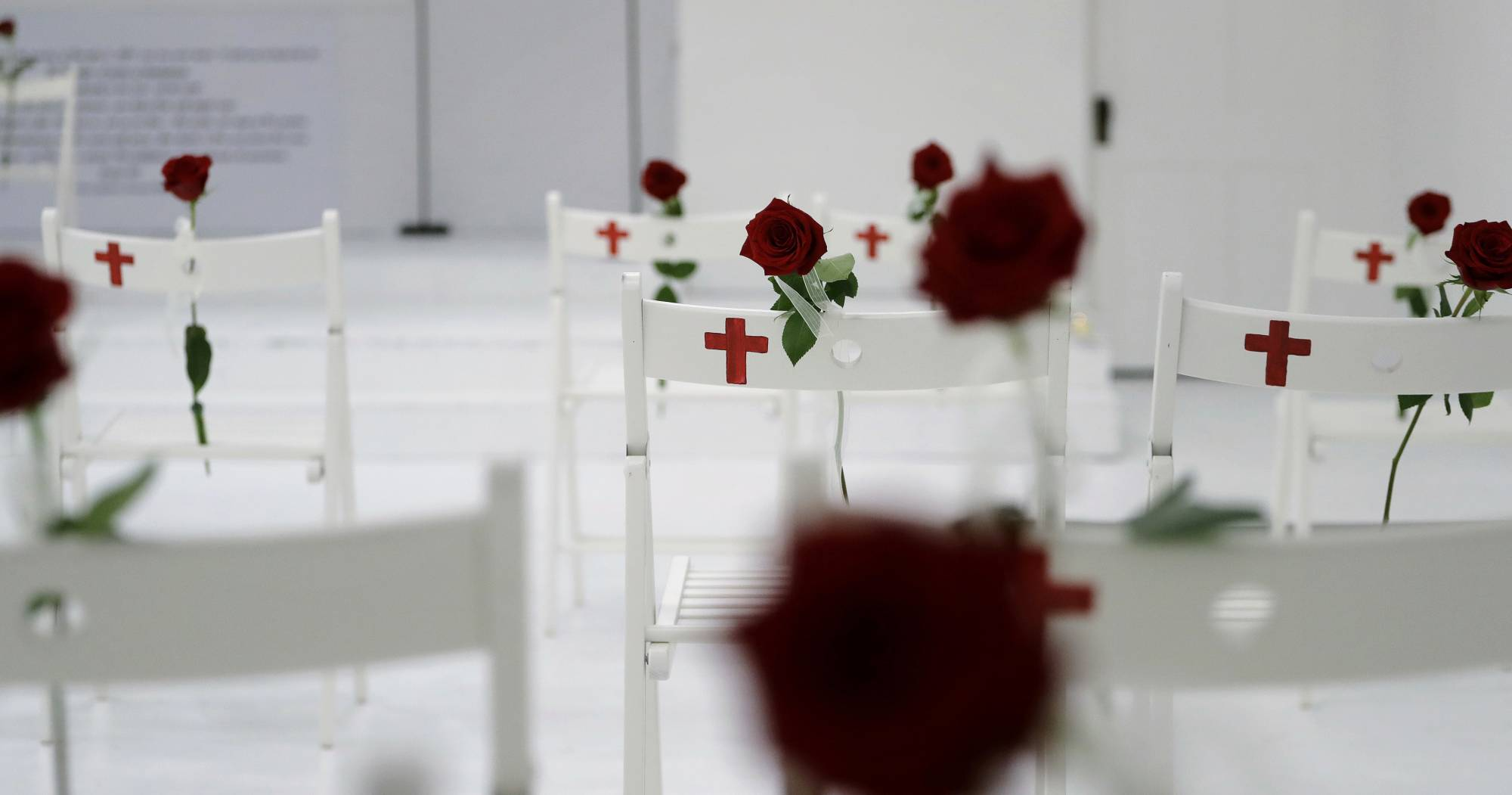 FILE - In this Nov. 12, 2017, file photo, a memorial for the victims of the shooting at Sutherland Springs First Baptist Church, including 26 white chairs each painted with a cross and and rose, is displayed in the church in Sutherland Springs, Texas. Republican leaders in gun-friendly Texas are stamping down the prospects of 'red flag' laws that would let enforcement seize some firearms from people who are deemed dangerous to themselves or others. Gun control advocates hoped for an opening after mass shootings at the church and high school within 6 months of each other. (AP Photo/Eric Gay, File)