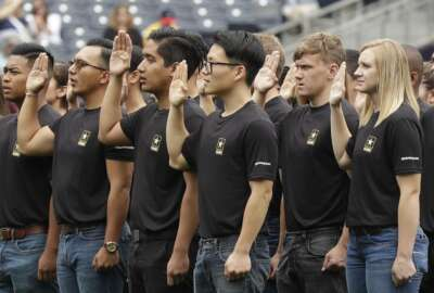 FILE - In this June 4, 2017, file photo. nNew Army recruits take part in a swearing in ceremony before a baseball game between the San Diego Padres and the Colorado Rockies in San Diego. The Army has missed its recruiting goal for the first time in more than a decade. Army leaders tell The Associated Press they signed up about 70,000 new troops for the fiscal year that ends Sept. 30, 2018. (AP Photo/Gregory Bull, File)
