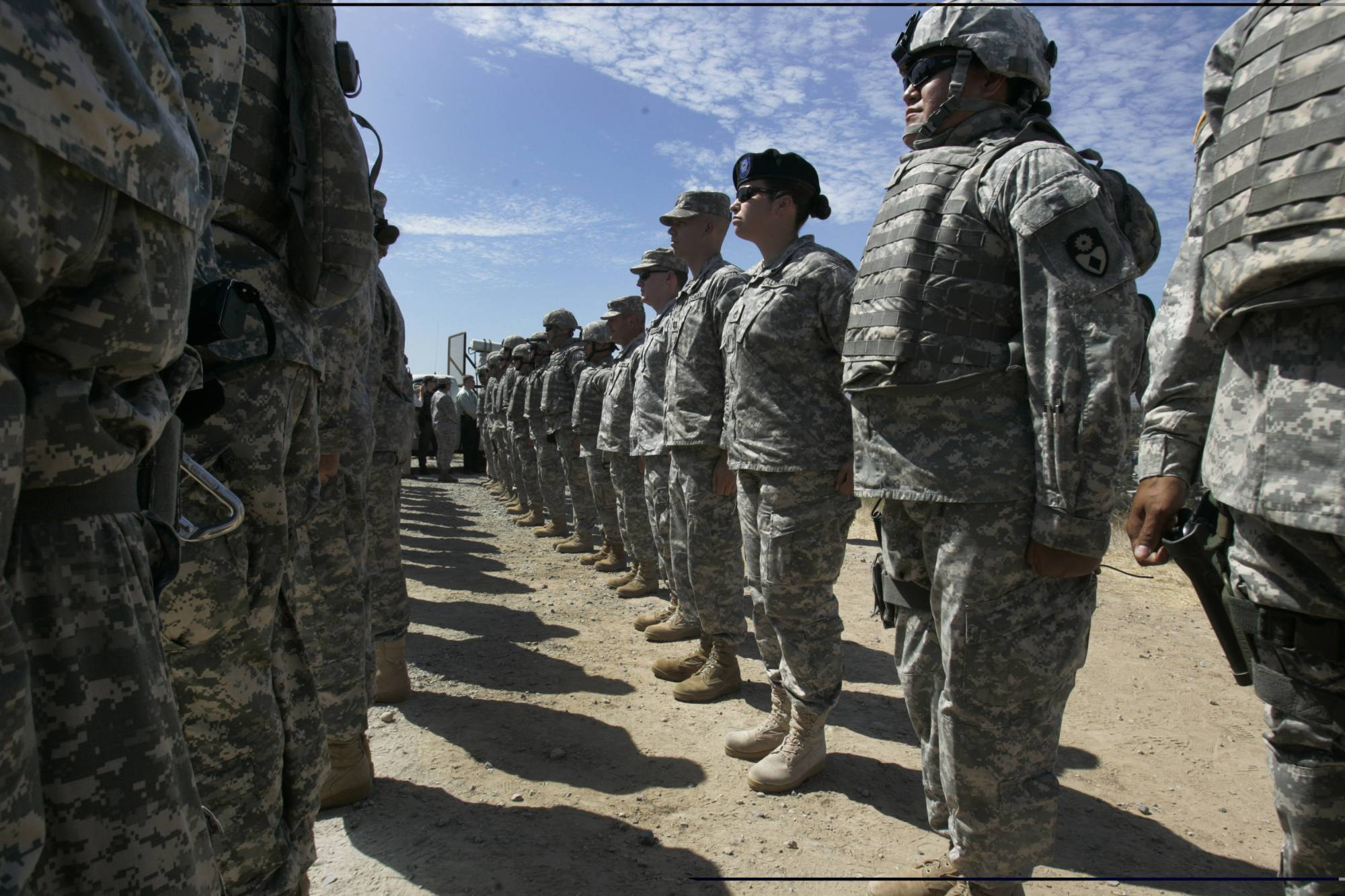 FILE - This Aug. 18, 2010, file photo shows California National Guard troops, who are part of Task Force Sierra, deployed at the border along with Border Patrol Agents near the California/Mexico border in San Diego. California Gov. Jerry Brown on Friday, Sept. 28, 2018, extended the state National Guard's participation in President Donald Trump's border deployment by six months, a low-key announcement that was made without any of the acrimony that characterized his early negotiations with the federal government. The California National Guard said in a press release that the mission will now run until the end of March 2019.  (John Gibbins/The San Diego Union-Tribune via AP, File)