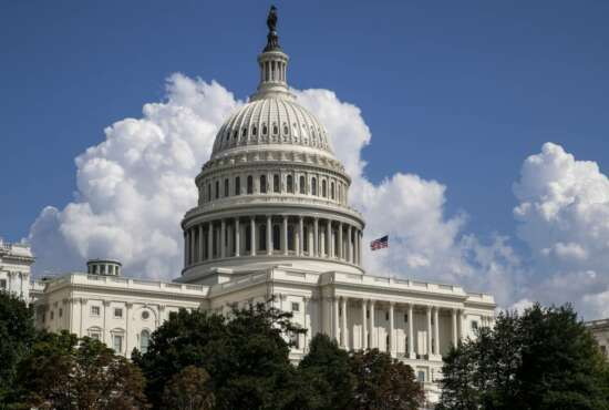 FILE- In this Sept. 3, 2018, file photo an American flag flies on the U.S. Capitol in Washington. On Thursday, Sept. 13, the Treasury Department releases federal budget data for August. (AP Photo/J. Scott Applewhite, File)