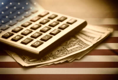 Calculator, dollars and USA flag. Sepia image.