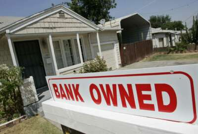 FILE- This Aug. 14, 2007, file photo shows a sign of a house under foreclosure in Antioch, Calif. As home values plummeted after the housing bubble burst in 2007, many borrowers with exotic types of loans were stuck, unable to refinance as lenders began to tighten their lending criteria. That set the stage for cascading mortgage defaults. (AP Photo/Paul Sakuma, File)
