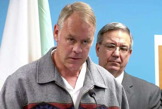 In this image made from a WLOS-TV livestream, Interior Secretary Ryan Zinke addresses reporters at a news conference on Thursday, Sept. 27, 2018, in Asheville, N.C. Zinke was announcing that 76 people were arrested on drug charges in a sweep of traffickers on western North Carolina tribal land in a sweep by federal, state and local officers. (WLOS-TV via AP)