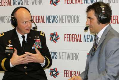 Maj. Gen. John Morrison, Jared Serbu at the 2018 Association of the US Army