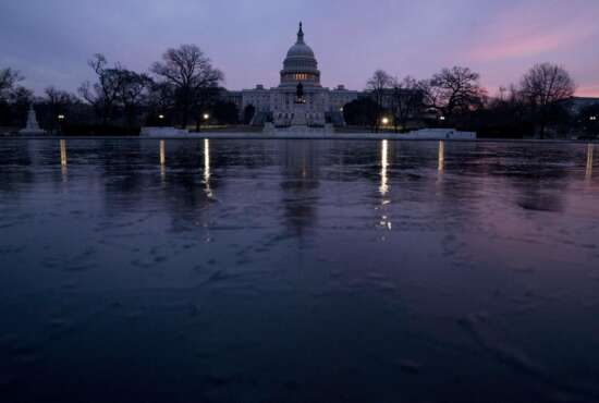 FILE - This Feb. 9, 2018, file photo shows the Capitol Dome of the Capitol Building at sunrise in Washington. The federal budget deficit has surged to $779 billion in fiscal 2018, its highest level in six years as President Donald Trump's tax cuts caused the government to borrow more heavily in order to cover its spending. The Treasury Department said Monday, Oc. 15, that the deficit climbed $113 billion from fiscal 2017. (AP Photo/Andrew Harnik, File)