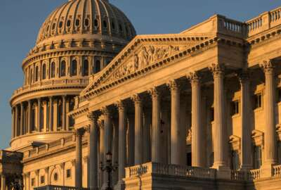 FILE - This Oct. 1, 2018, file photo, shows the Capitol at sunrise in Washington. Republicans have begun to concede defeat in the evolving fight to preserve the House majority. The party's candidates may not go quietly, but from Arizona to Colorado to Iowa, the GOP's most powerful players are shifting resources away from vulnerable Republican House candidates deemed too far gone and toward those thought to have a better chance of political survival. (AP Photo/J. Scott Applewhite, File)