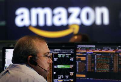 FILE- In this Sept. 4, 2018, file photo a Nasdaq employee monitors market activity in New York. Investors were ravenous for companies able to add customers and deliver fat growth. So they were willing to pay premium prices for an Amazon or a Netflix. Left behind were stocks in more staid industries, even if they had more attractive prices relative to their profits. (AP Photo/Mark Lennihan, File)
