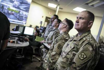 This April 7, 2018 image provided by U.S. Customs and Border Protection shows members of the New Mexico Army National Guard liaison team visiting the U.S. Border Patrol El Paso Sector Intelligence Operations Center. (U.S. Customs and Border Protection via AP)