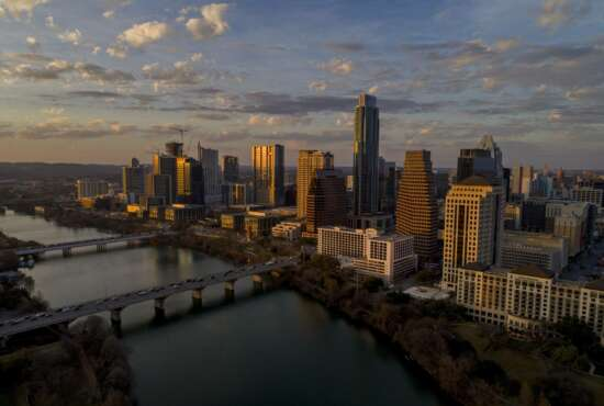 FILE - This Feb. 7, 2018, file photo shows the skyline in Austin, Texas. For more than a year, cities around the country, including Austin, waited in suspense over whether they'd be chosen as Amazon's second home. On Tuesday, Nov. 13, Amazon announced that it had picked for its new East Coast headquarters the New York neighborhood of Long Island City, Queens as well as a suburb of Washington, in Arlington, Va. (Jay Janner/Austin American-Statesman via AP, File)