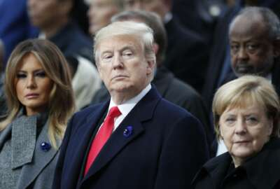 President Donald Trump, his wife Melania Trump, left, and German Chancellor Angela Merkel attend ceremonies at the Arc de Triomphe Sunday, Nov. 11, 2018 in Paris. . Over 60 heads of state and government were taking part in a solemn ceremony at the Tomb of the Unknown Soldier, the mute and powerful symbol of sacrifice to the millions who died from 1914-18.. (AP Photo/Francois Mori, Pool)