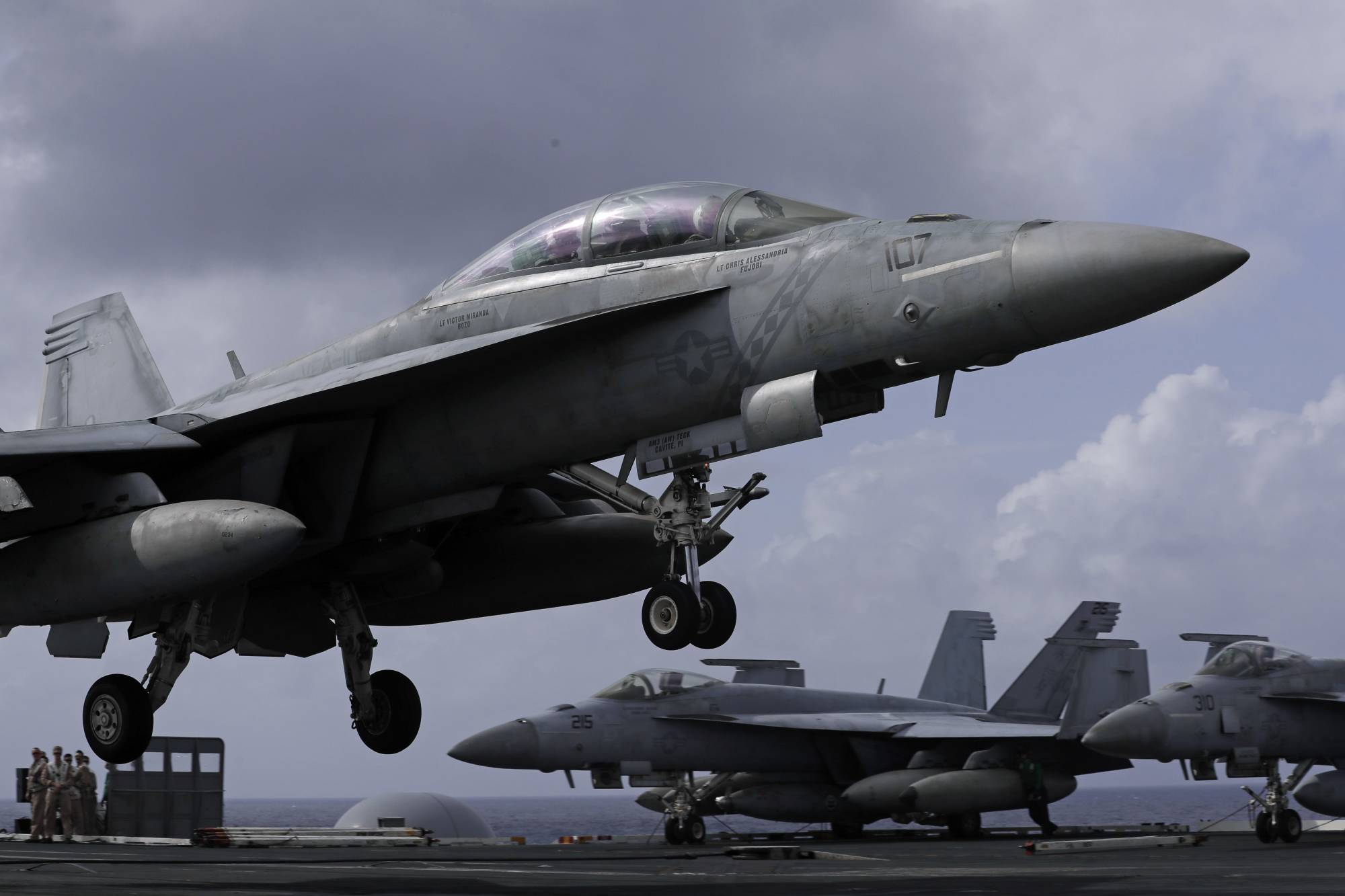 An F/A-18 Super Hornet fighter jet lands on the deck of the U.S. Navy USS Ronald Reagan in the South China Sea, Tuesday, Nov. 20, 2018. China is allowing a U.S. Navy aircraft carrier and its battle group to make a port call in Hong Kong after it earlier turned down a similar request amid tensions with Washington. (AP Photo/Kin Cheung)