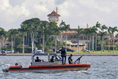 The U.S. Coast Guard patrol boat passes President Donald Trump's Mar-a-Lago estate in Palm Beach, Fla., Thursday, Nov. 22, 2018. President Trump made a Thanksgiving Day call to members of the U.S. military from his estate before traveling to a nearby Coast Guard Station to meet with members of the U.S. Coast Guard personally. (AP Photo/J. David Ake)